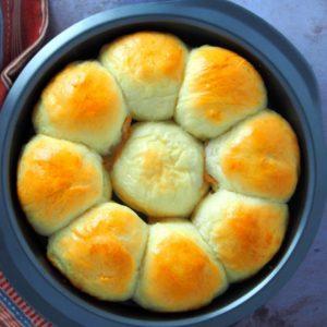 Top shot angle of dulce de leche bread rolls in a baking pan.