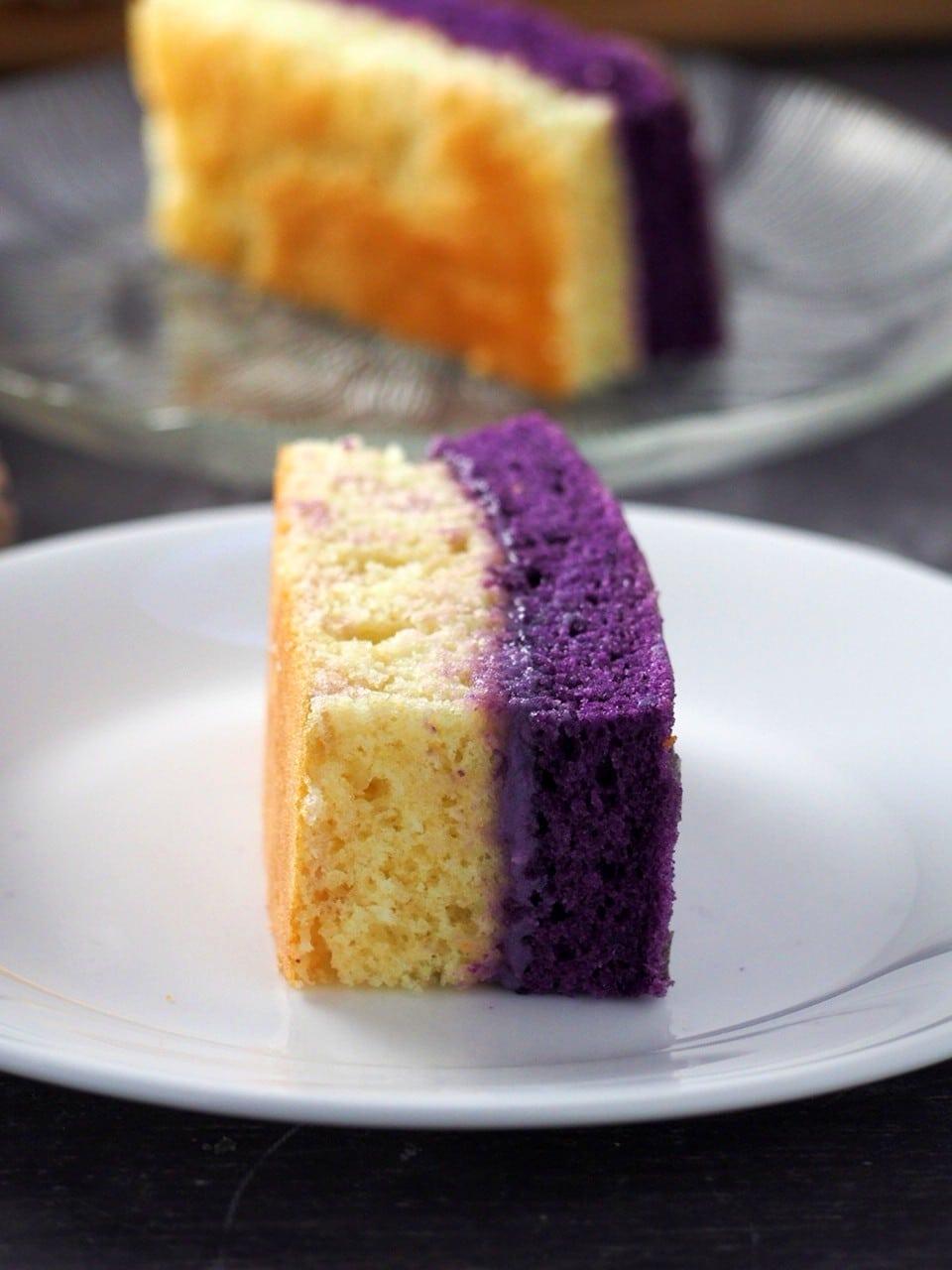 Close up of an ube and vanilla chiffon cake slice.