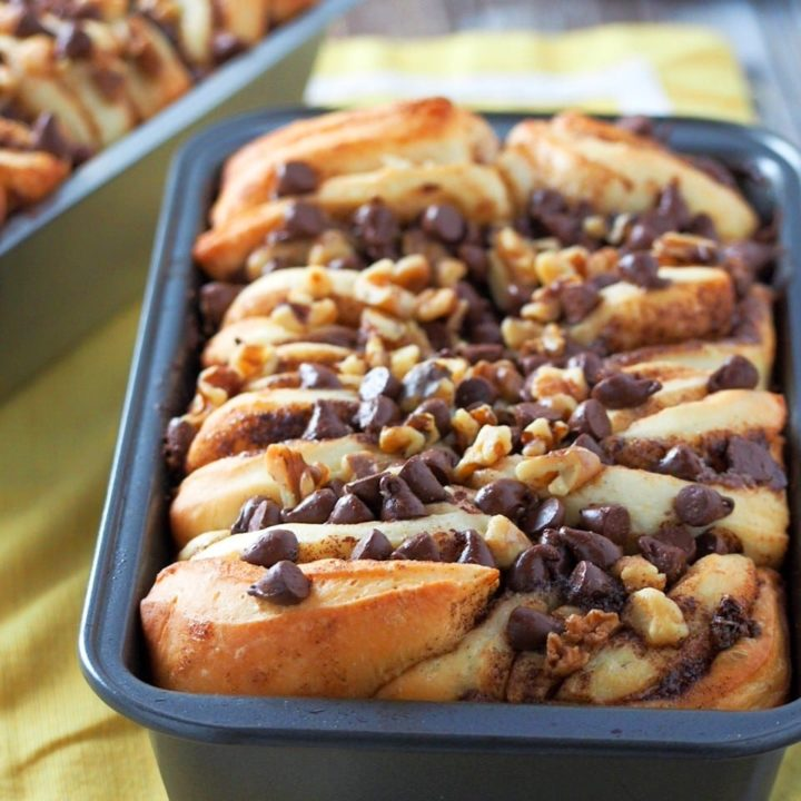 Close up view of pull-apart cinnamon milk bread in a loaf pan.