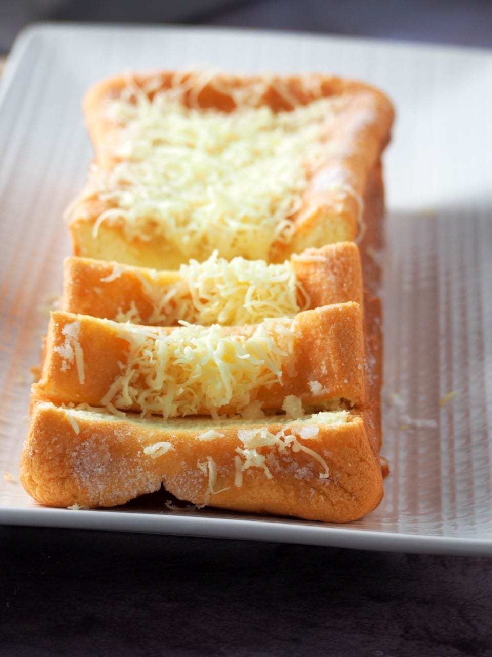 Sliced loaf of Taisan on a serving plate.