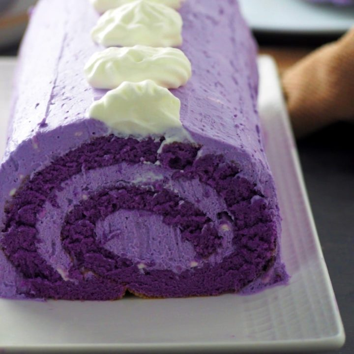 Close up shot of ube cake roll.