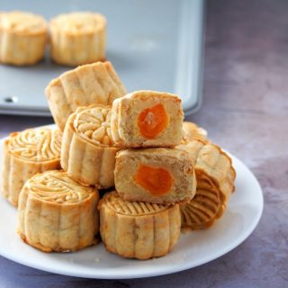 Moon Cake photo showing a sliced piece to expose the fillings inside.
