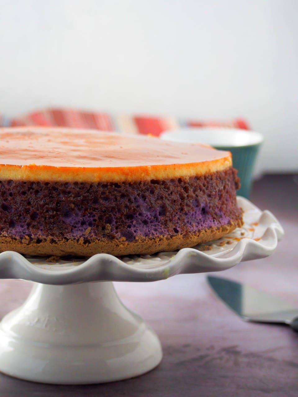 Ube Flan cake on a cake stand.