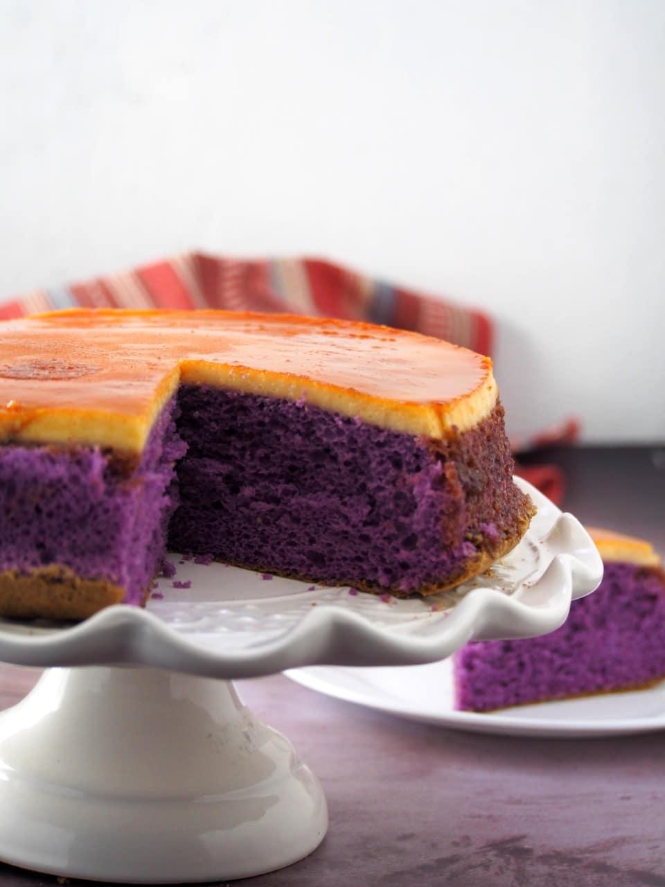 Sliced Ube flan cake on a cake stand.