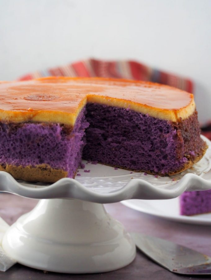 Ube flan cake close up shot on a cake stand.