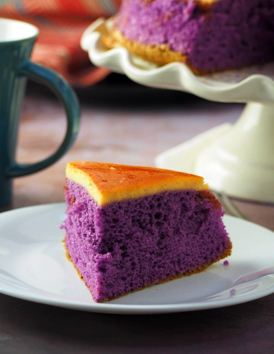 A slice of ube flan cake on a plate.