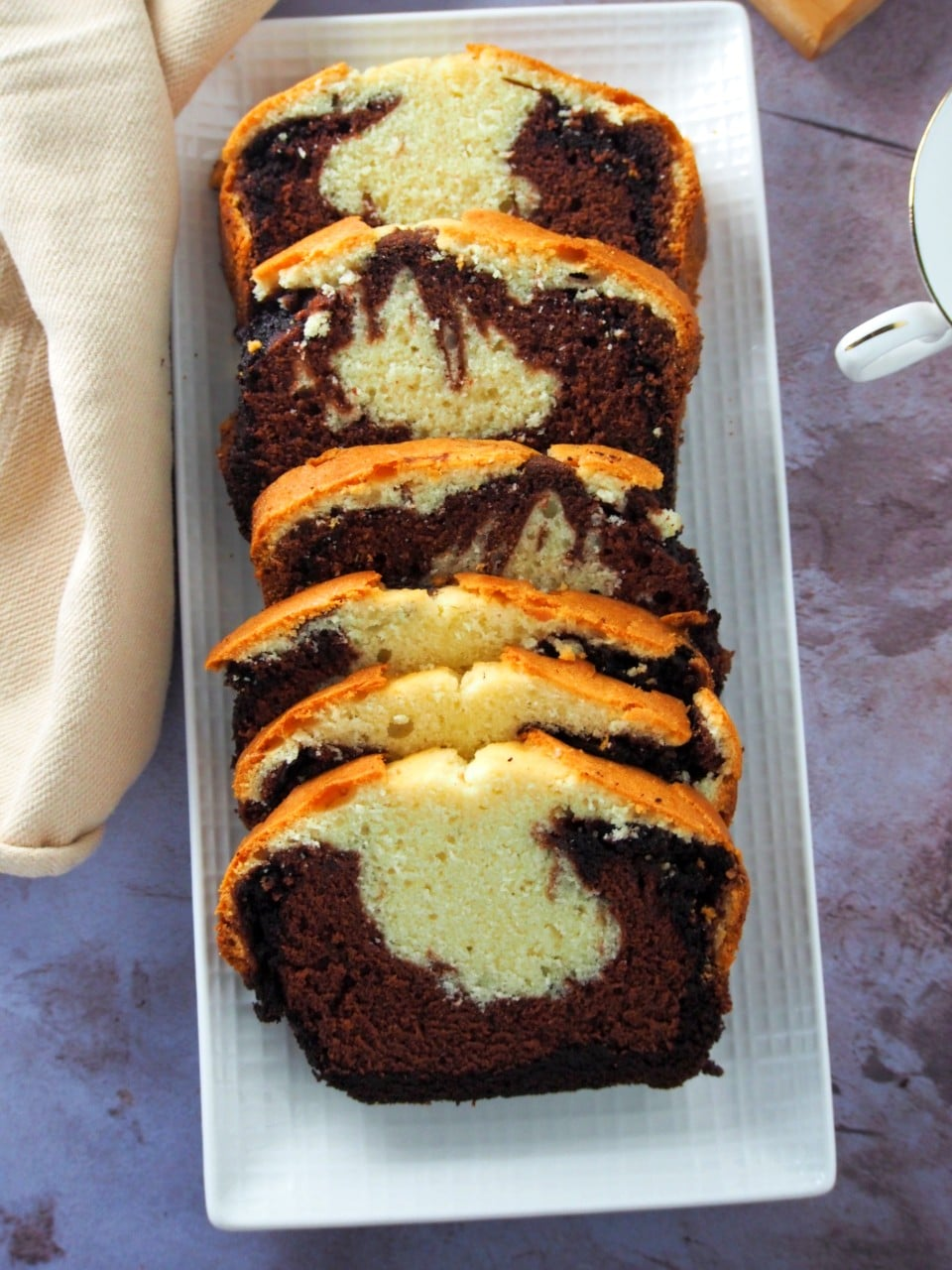 Chocolate ombre pound cake slices arranged on a serving dish.