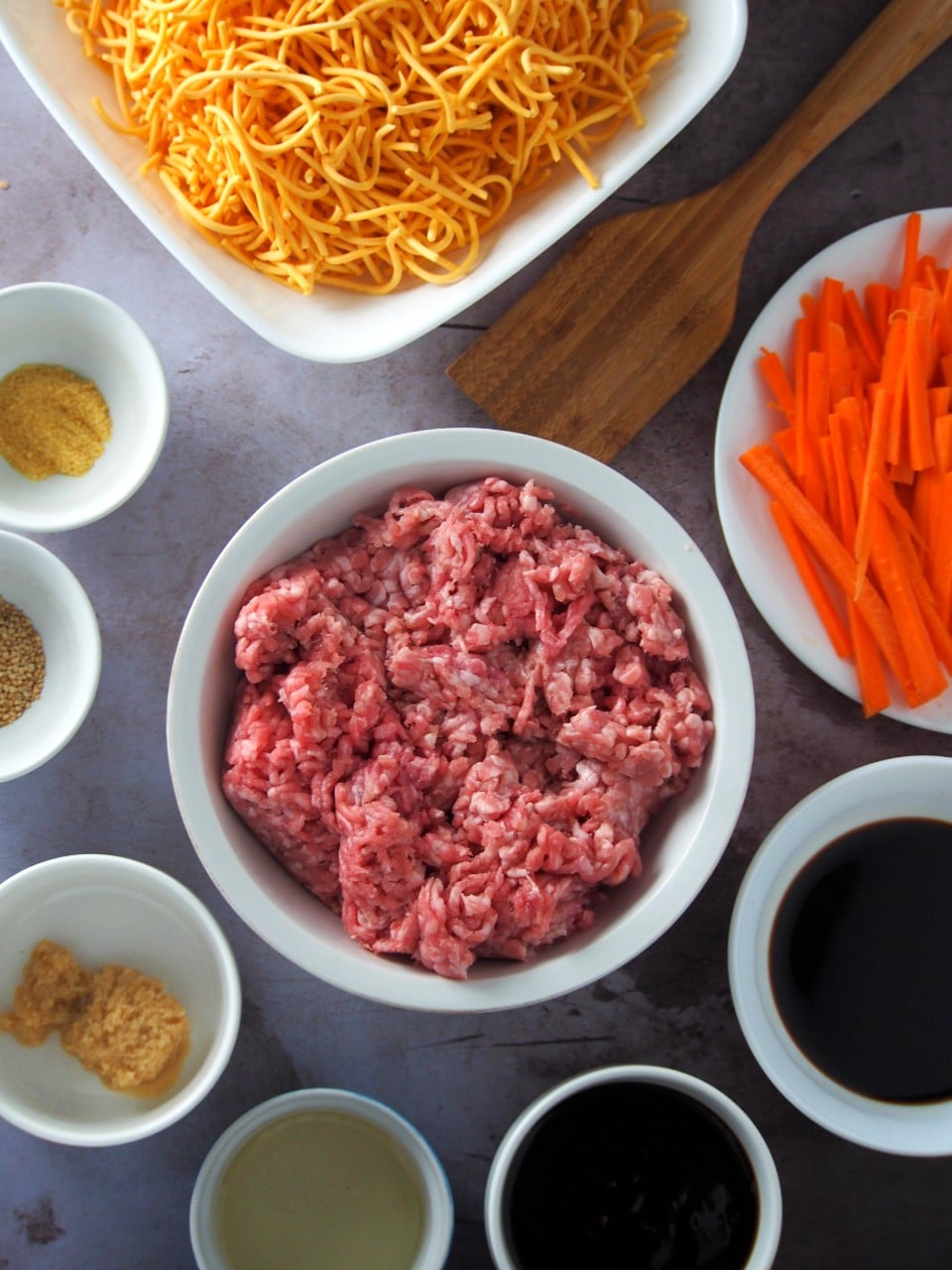 Ground pork, carrots, noodles and sauces for the Garlic pork Chow mein.