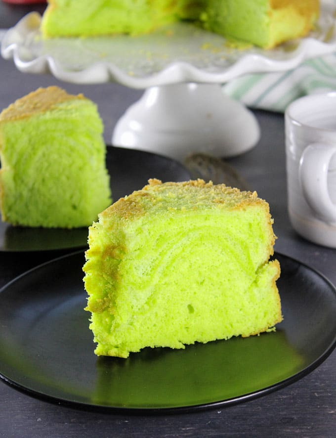 Pandan chiffon cake slices served on plates.