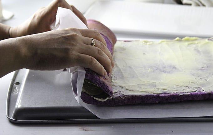Rolling the ube pianono cake.