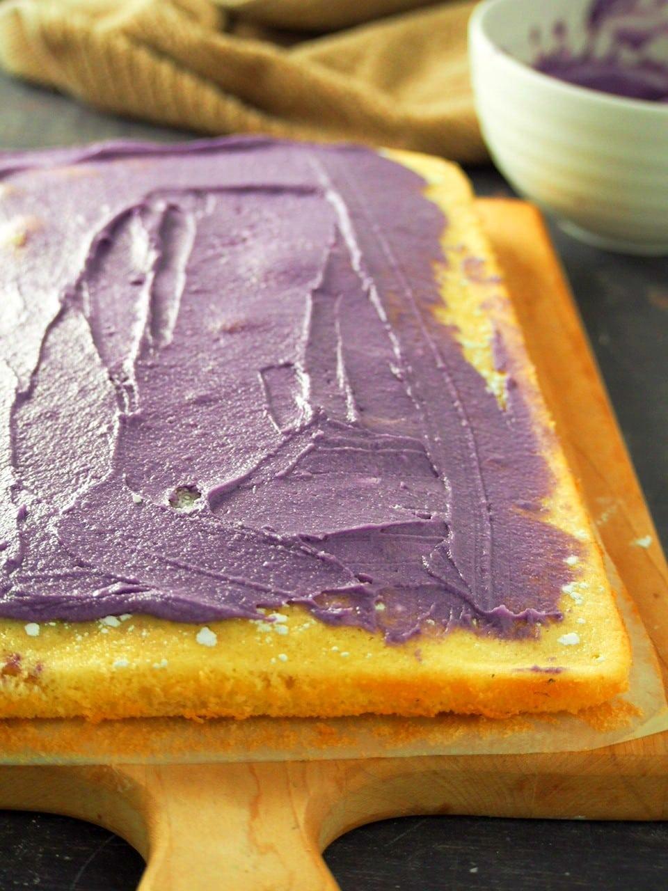 Spreading the buttercream on the vanilla cake.