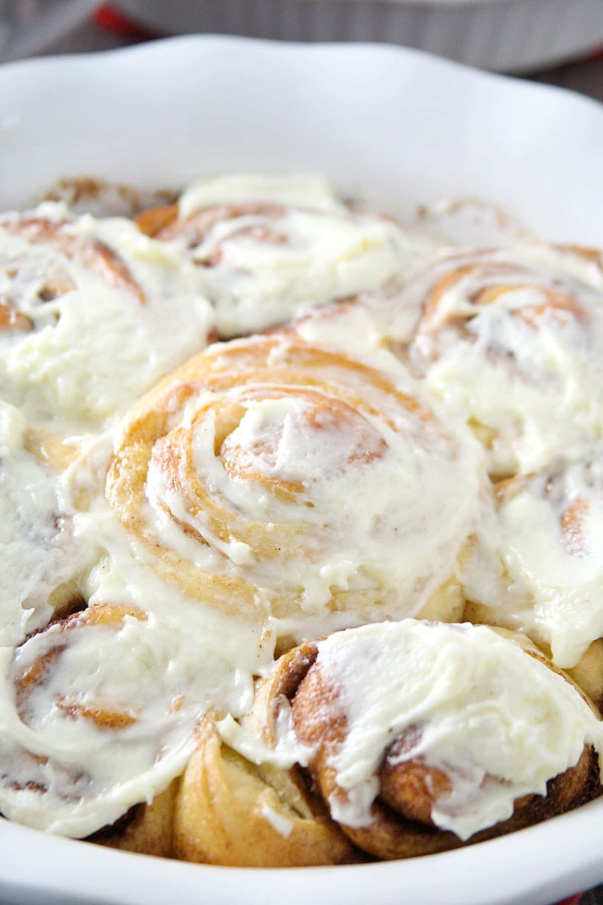 Close up shot of the iced bread machine cinnamon rolls.