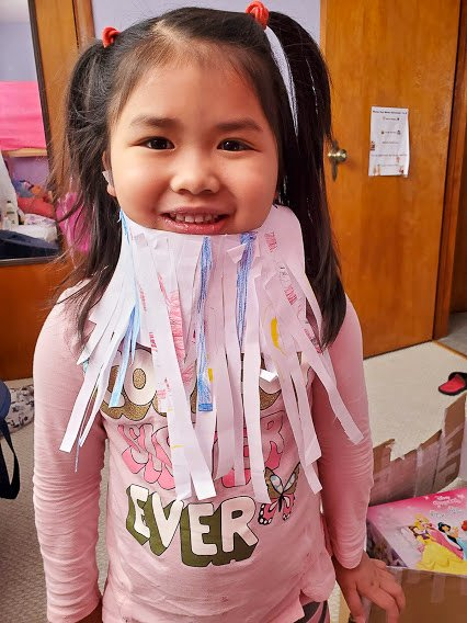 girl with paper beard