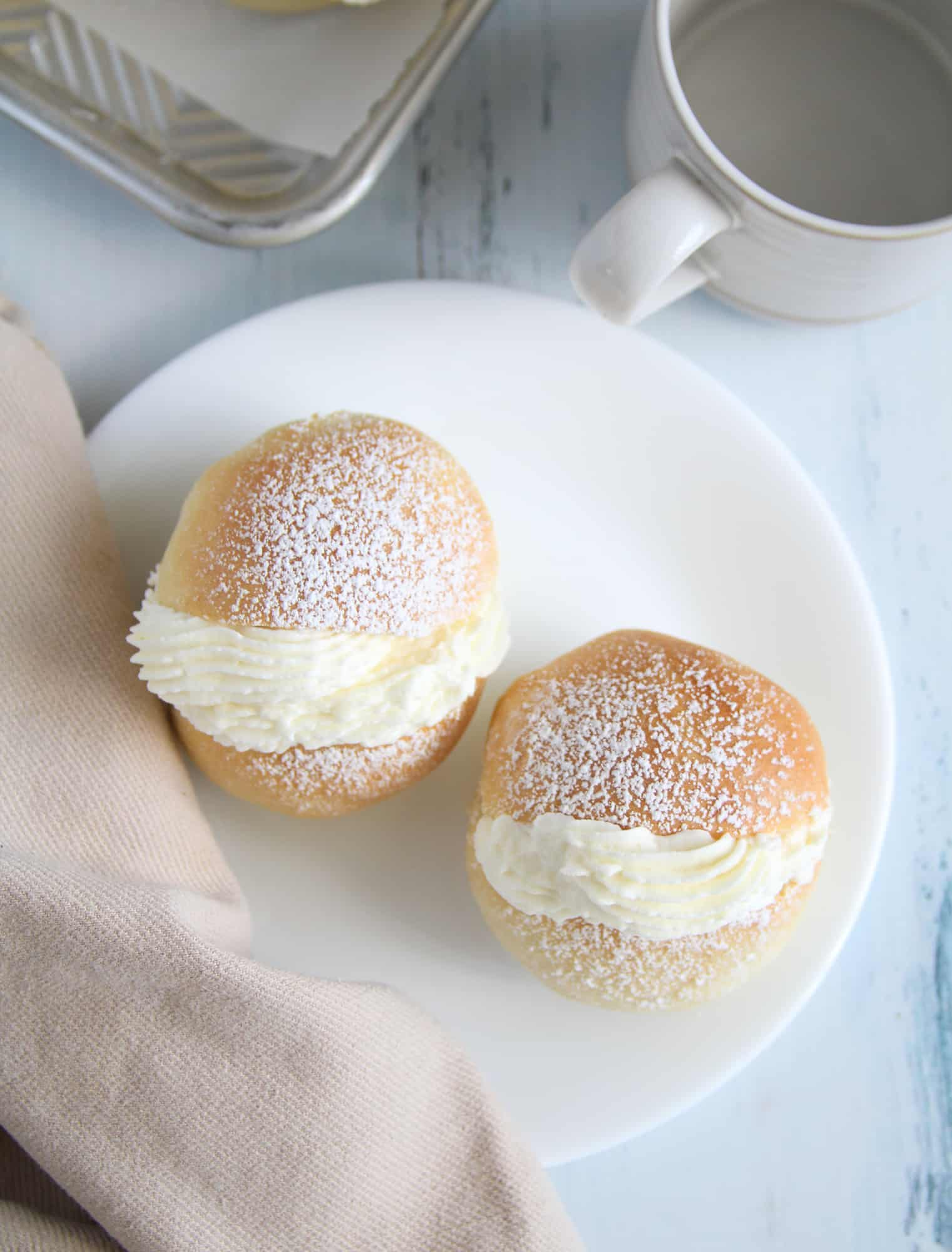 Top view of cream buns on a plate.