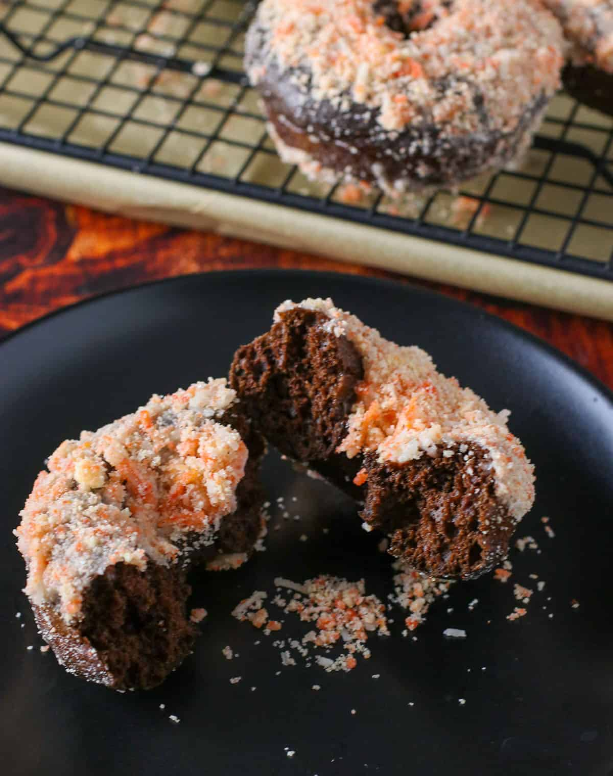 Choco butternut donut, cut in half showing the interior of the donut.